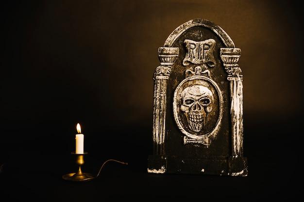 Gravestone and candlestick