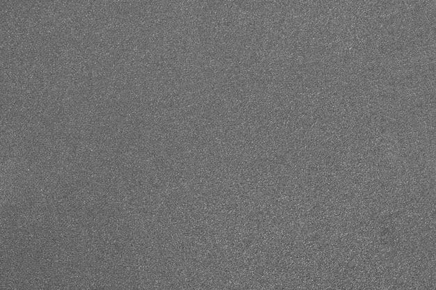 Серый крупный план наждачной бумаги. зернистая текстура.