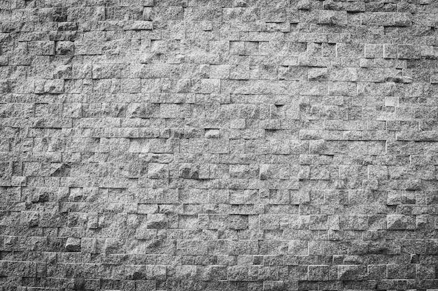 グレーと黒の色の石レンガの質感と背景の表面