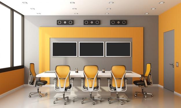 グレーとオレンジのモダンな会議室