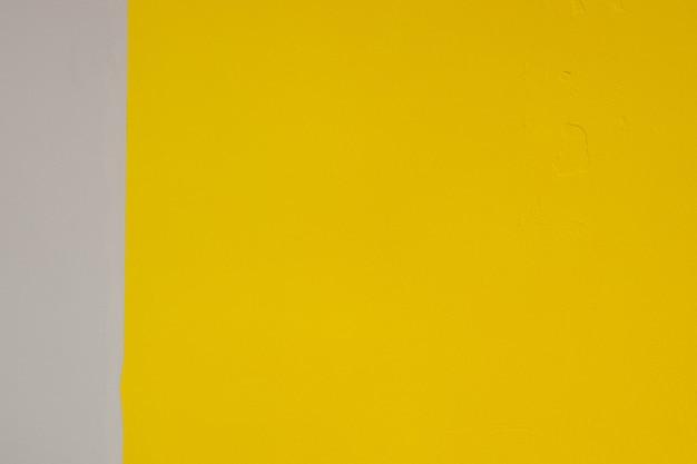 グレーと黄色のレンガの壁の背景モダンな理想的なインテリアデザインのメインカラートレンドオブザイヤーリックウォールの背景モダンな理想的なインテリアデザインのメインカラートレンドオブザイヤー