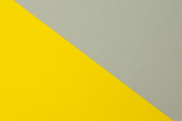 灰色と黄色の段ボール紙の背景、コピースペース、クローズアップ