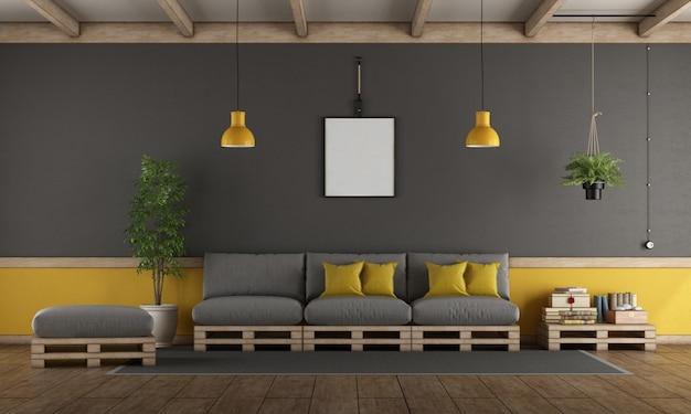 パレットソファ付きのグレーと黄色のリビングルーム