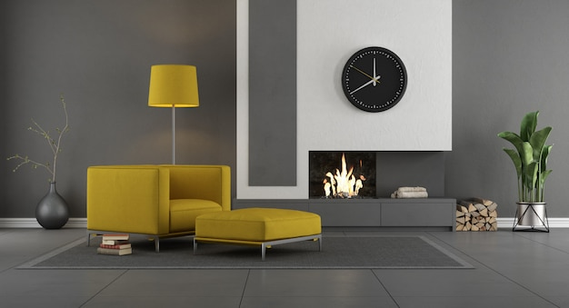 暖炉、アームチェア、フットスツール付きのグレーと黄色のモダンなリビングルーム