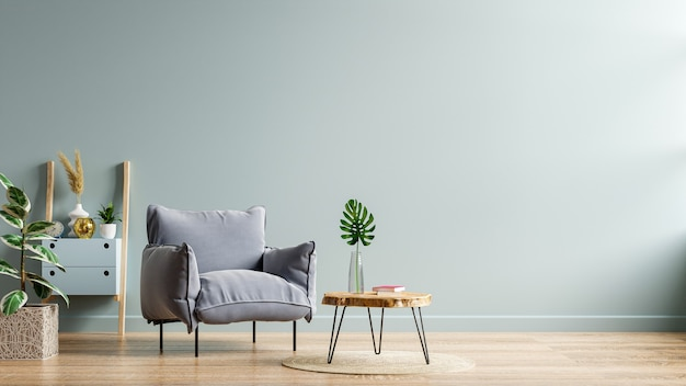 Gray armchair and a wooden table in living room interior with plant,dark blue wall.3d rendering