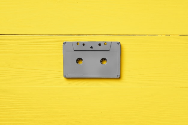 Gray audio cassettes on yellow top view