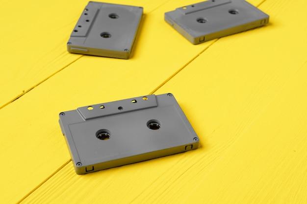 Gray audio cassettes on yellow