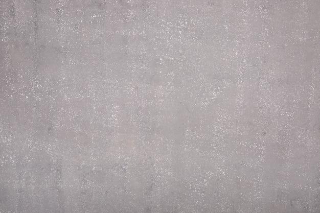 Gray background under concrete, wet asphalt.