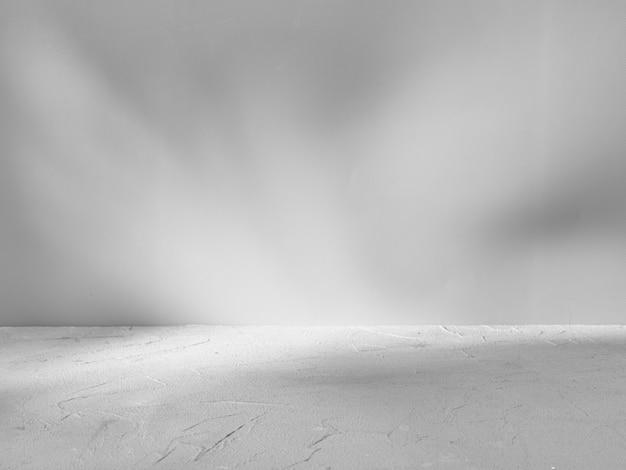 日光のまぶしさを伴う製品プレゼンテーションの灰色の背景