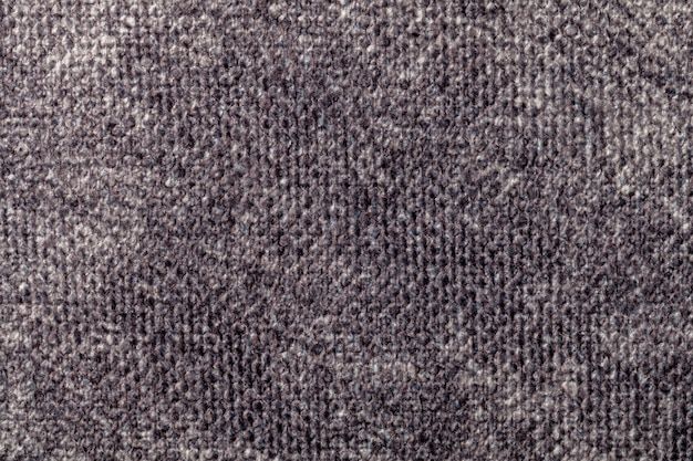 Gray background from soft textile material. fabric with natural texture.