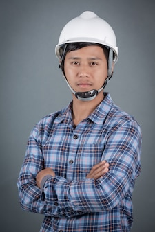 Gray background male engineer.