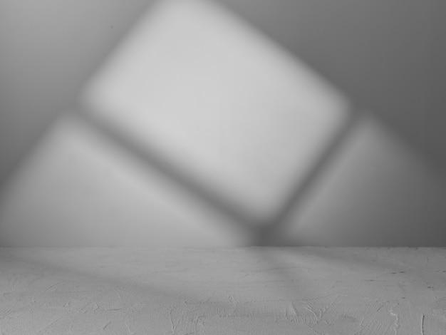 제품 프리젠 테이션을 위해 창에서 나오는 빛이있는 회색 배경