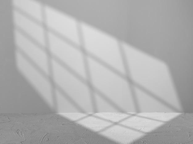 Серый фон со светом из окна для презентации продукта