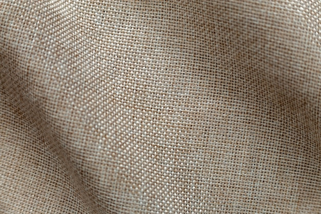 Gray beige linen canvas surface background. sackcloth design, ecological cotton textile, fashionable woven flex burlap.