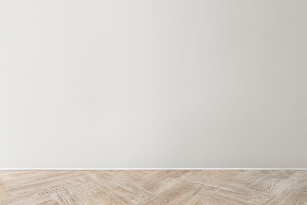 Gray blank concrete wall mockup with a wooden floor