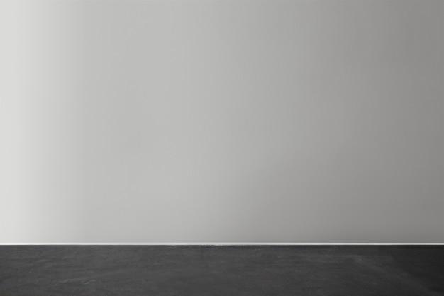 Modello di muro di cemento bianco grigio con un pavimento in legno