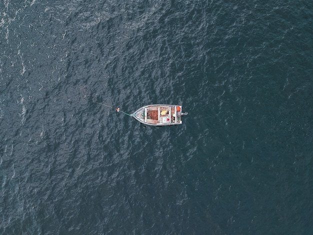 Gray boat on body of water during daytime