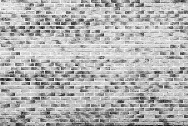 Серая кирпичная стена здания. интерьер современного лофта. фон для дизайна.
