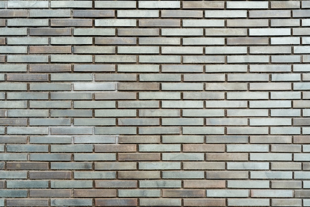 Gray brick wall architectural background