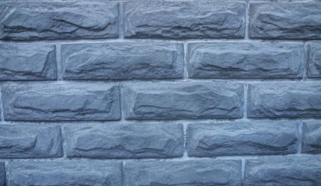 背景として灰色のレンガの壁