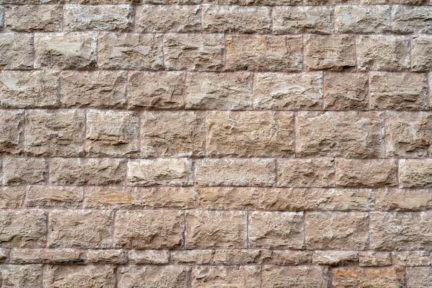 灰色のレンガの壁。ロフトのインテリアデザイン。ファサードの灰色のペンキ。