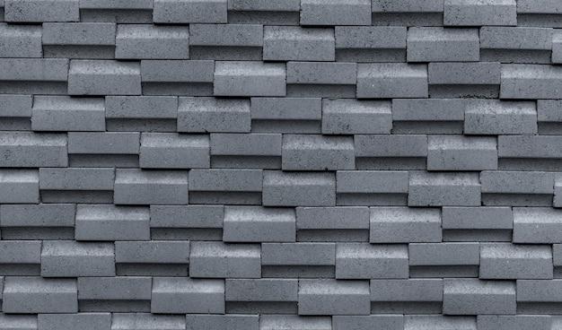 シンプルなパターンの灰色のレンガの壁。灰色の壁のテクスチャの抽象的な背景。