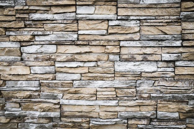 Gray brown brick wall. stone texture, background