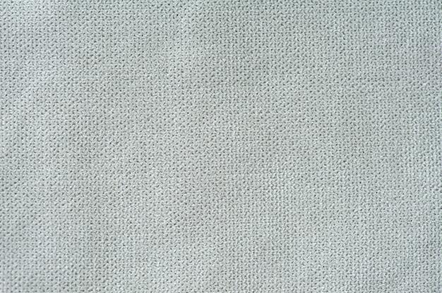 背景の灰色のキャンバスの表面のテクスチャ