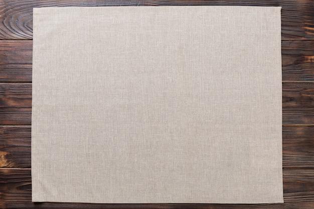 Gray cloth napkin on rustic dark
