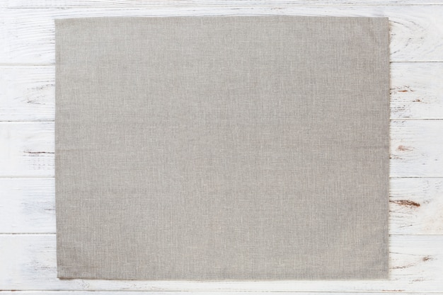 Gray cloth napkin on white rustic wooden surface