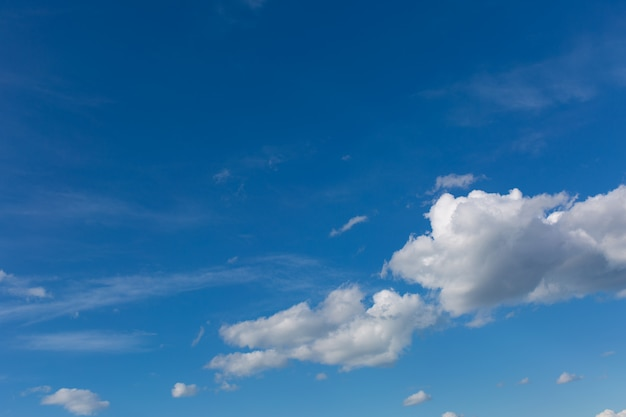 Gray clouds on blue sky .