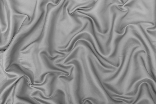 Серый цвет шелковой ткани фона