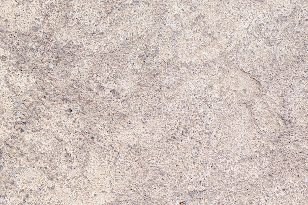 Gray concrete background with small inclusions