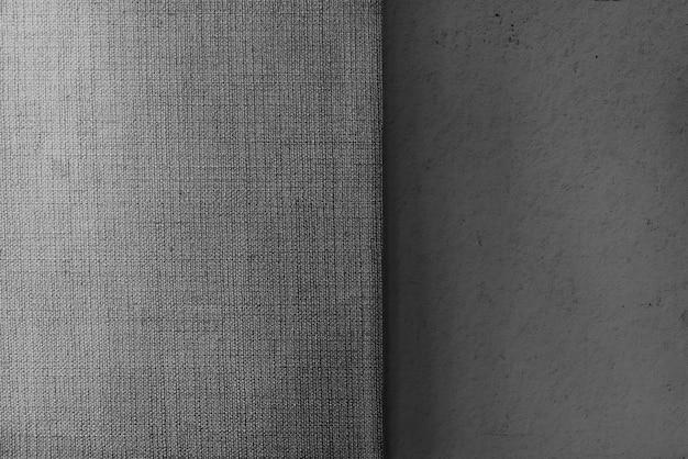Fondo strutturato grigio del tessuto della tela e del cemento