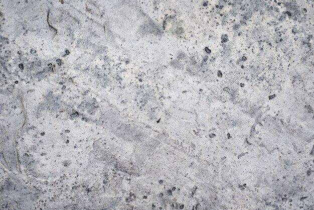 Gray concrete wall as background. stone texture closeup
