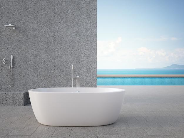 Серая бетонная стена с душем на открытом воздухе и ванной