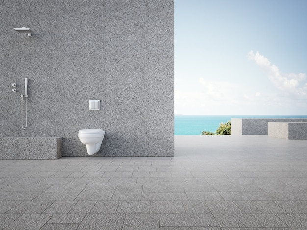 Gray concrete wall with outdoor shower