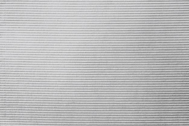 Fondo strutturato del tessuto di velluto a coste grigio