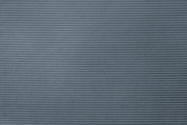 灰色のコーデュロイ生地の織り目加工の背景