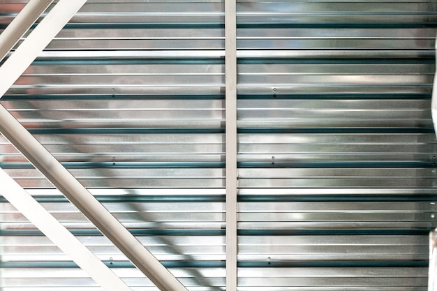 Gray corrugated metal sheet wall of industrial building