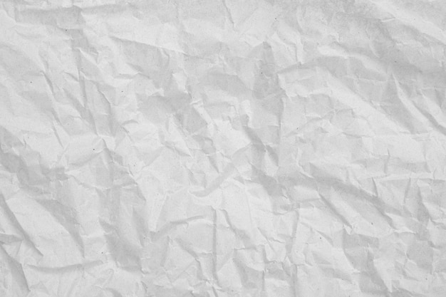 Gray crumpled paper empty background.texture of gray creased paper