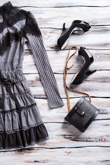 Gray dress and black bag. luxury heels and classic purse. lady's dark spring apparel. goods at extremely low price.