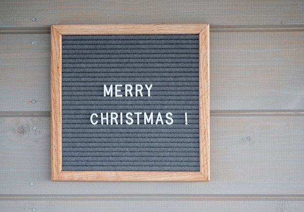 Gray felt board with english text merry christmas
