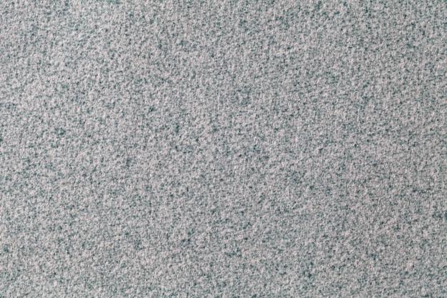Серый пушистый из мягкой ворсистой ткани.