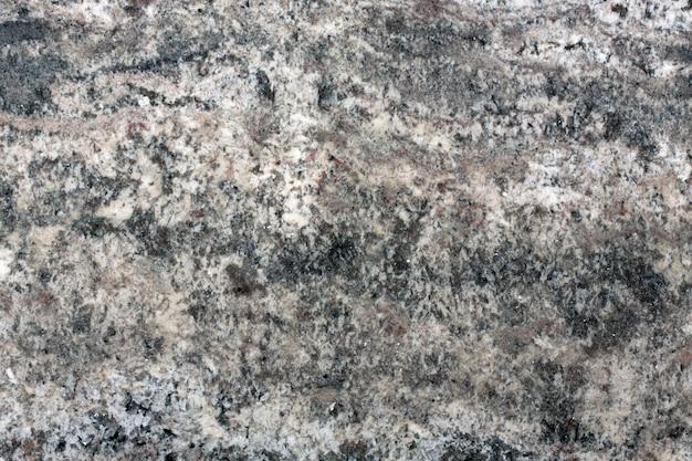 灰色の花崗岩パターンのテクスチャ背景。高解像度の写真。