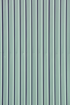Gray green galvanized steel plate as fence wall,seamless abstract background with vertical lines