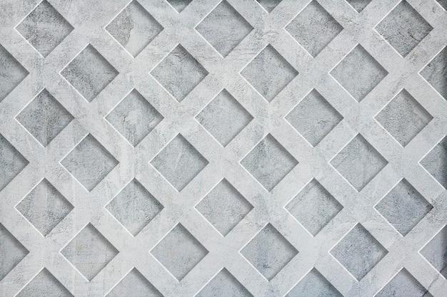 Fondo strutturato della parete del cemento di griglia grigia