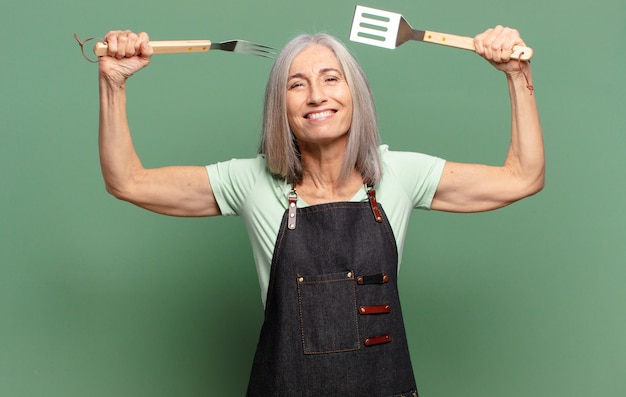 Gray hair pretty  barbecue chef woman