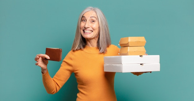 Gray hair pretty woman holding take away food and wallet