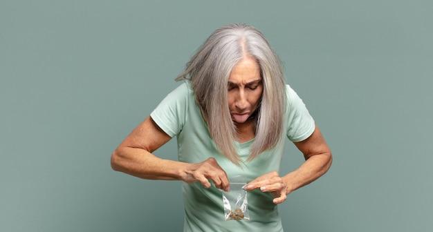 Gray hair pretty woman with marihuana